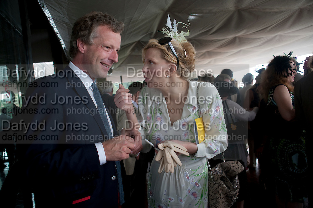 COURTNEY LOVE; HUGO BURNAND IN THE DUKE OF RICHMOND BOX, Glorious Goodwood. Ladies Day. 28 July 2011. <br /> <br />  , -DO NOT ARCHIVE-&copy; Copyright Photograph by Dafydd Jones. 248 Clapham Rd. London SW9 0PZ. Tel 0207 820 0771. www.dafjones.com.
