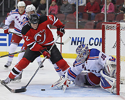 Nov 5, 2010; Newark, NJ, USA;  New York Rangers goalie Henrik Lundqvist (30) makes a save on New Jersey Devils center Brad Mills (22) during the first period at the Prudential Center.