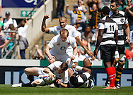 Picture by Andrew Tobin/Tobinators Ltd +44 7710 761829.26/05/2013.Freddie Burns of England scores the first try during the match between England and the Barbarians at Twickenham Stadium, Twickenham.