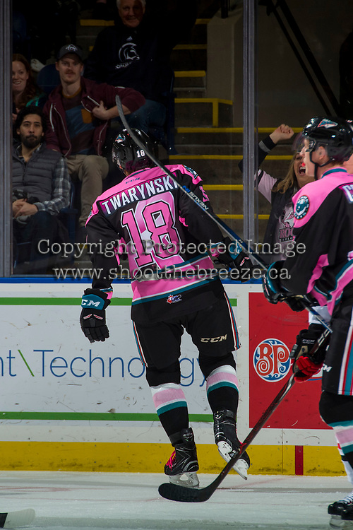 KELOWNA, CANADA - OCTOBER 21: Carsen Twarynski #18 of the Kelowna Rockets skates to the glass to celebrate his third goal and the hat trick against the Portland Winterhawks on October 21, 2017 at Prospera Place in Kelowna, British Columbia, Canada.  (Photo by Marissa Baecker/Shoot the Breeze)  *** Local Caption ***