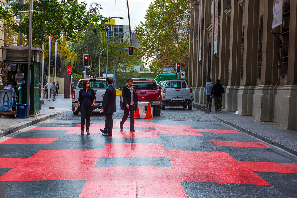 Santiago, Chile--April 6, 2018. People are walking and conversing on a checkerboard street. Editorial Use Only.