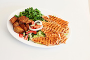 Grilled poultry breast with salad and potatoes