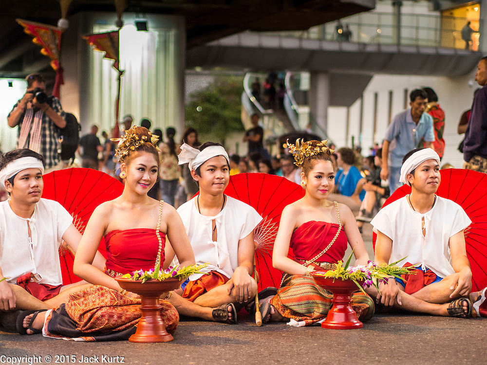 "14 JANUARY 2015 - BANGKOK, THAILAND:  People participating in the 2015 Discover Thainess parade take a break during the parade. The Tourism Authority of Thailand (TAT) sponsored the opening ceremony of the ""2015 Discover Thainess"" Campaign with a 3.5-kilometre parade through central Bangkok. The parade featured cultural shows from several parts of Thailand. Part of the ""2015 Discover Thainess"" campaign is a showcase of Thailand's culture and natural heritage and is divided into five categories that match the major regions of Thailand – Central Region, North, Northeast, East and South.    PHOTO BY JACK KURTZ"