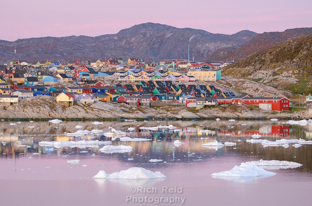 Ilulissat and glacial ice from Ilulissat Glacier reflecting in Disko Bay at last light, Greenland.