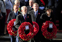© Licensed to London News Pictures. 13/11/2016. London, UK.  Labour party leader JEREMY CORBYN and British prime minster THERESA MAY attend a Remembrance Day Ceremony at the Cenotaph war memorial in London, United Kingdom, on November 13, 2016 . Thousands of people honour the war dead by gathering at the iconic memorial to lay wreaths and observe two minutes silence. Photo credit: Ben Cawthra/LNP