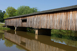 The Watson Mill Bridge in the Watson Mill Bridge State Park near Carlton, Georgia.  The park is home to the longest original-site covered bridge in Georgia, which spans 229 feet across the South Fork River. The bridge, being more than 100 years old, is supported by a town lattice truss system held firmly together with wooden pins.