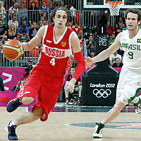 02 August 2012: Russia Alexey Shved drives past Marcelinho Huertas during 75-74 Team Russia victory over Team Brazil, during the men's basketball preliminary, at the Basketball Arena, in London, Great Britain.