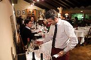 Italie, Fumane, 20080403.<br /> Restaurant Enoteca della Valpolicella bij avondlicht.<br /> Sfeervol, gerenomeerd restaurant in Fumane<br /> Samen met een wijnkelder met meer dan 700 wijnen<br /> kelner bereid de wijnglazen voor. Een kleine hoeveelheid wijn wordt gewalsd om de aroma's en de geur te laten vrijkomen.<br /> <br /> Italy, Fumane 20,080,403.<br /> Restaurant Enoteca della Valpolicella in evening light.<br /> Attractive, well-established restaurant in Fumane<br /> Along with a wine cellar with more than 700 wines<br /> <br /> <br /> <br /> Sas di Riolfi A. e C. <br /> Via Osan, 45 <br /> 37022 FUMANE