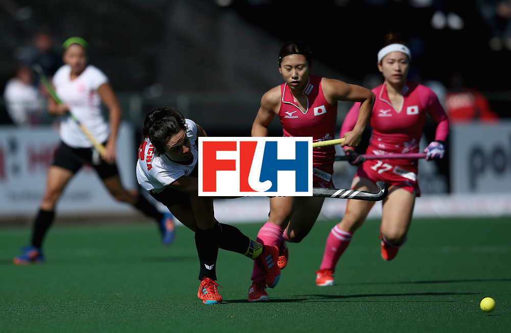 JOHANNESBURG, SOUTH AFRICA - JULY 14: Marlena Rybacha of Poland passes the ball under pressure from Yuri Nagai and Hazuki Nagai of Japan  during day 4 of the FIH Hockey World League Semi Finals Pool B match between Poland and Japan at Wits University on July 14, 2017 in Johannesburg, South Africa. (Photo by Jan Kruger/Getty Images for FIH)