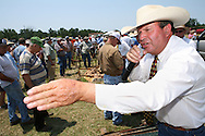 Auctioneer E.B. Harris's cattle and farm equipment auction in Clinton, North Carolina on Saturday June 30th, 2012.