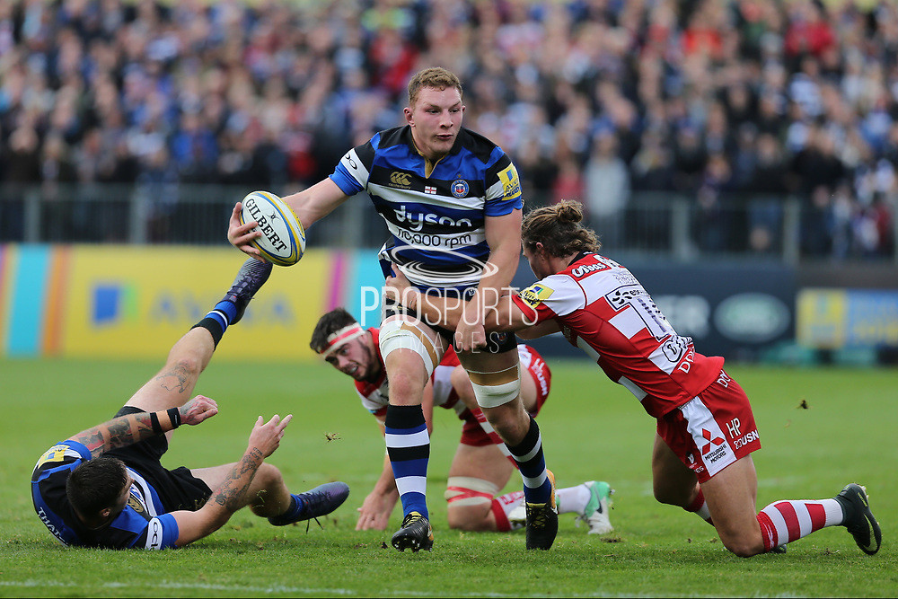 Bath flanker Sam Underhill (7)  holds up the ball in a tackle during the Aviva Premiership match between Bath Rugby and Gloucester Rugby at the Recreation Ground, Bath, United Kingdom on 29 October 2017. Photo by Gary Learmonth.
