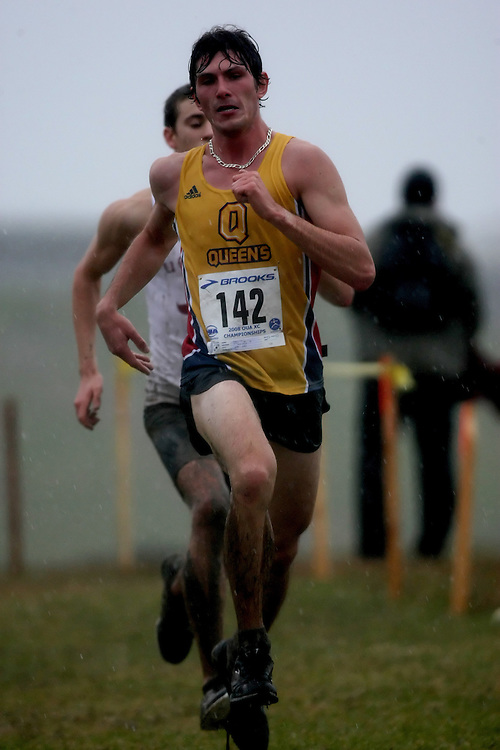 (Kingston, ON---25 October 2008) Clay Patterson of QUEEN'S University running to finish 38 in the 2008 Ontario University Athletics men's cross country championship.  Photograph copyright Sean Burges/Mundo Sport Images (www.msievents.com).