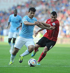 Manchester City's Sergio Aguero attacks inside the box with pressure from Cardiff City's Gary Medel  - Photo mandatory by-line: Alex James/JMP - Tel: Mobile: 07966 386802 25/08/2013 - SPORT - FOOTBALL - Cardiff City Stadium - Cardiff -  Cardiff City V Manchester City - Barclays Premier League