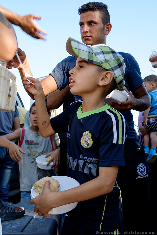 Food distribution. <br /> Refugee camp Kara Tepe near Mytilene city. It hosts Syrian refugees who are waiting for their registration papers that will allow them to stay in Greece for some time till they can move to an other European country.
