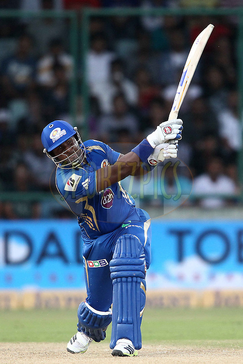 Dwayne Smith of Mumbai Indians hits over the top for six during match 19 of the Karbonn Smart Champions League T20 between the Perth Scorchers and the Mumbai Indians held at the Feroz Shah Kotla Stadium, Delhi on the 2nd October 2013<br /> <br /> <br /> Photo by Shaun Roy-CLT20-SPORTZPICS <br /> <br /> Use of this image is subject to the terms and conditions as outlined by the CLT20. These terms can be found by following this link:<br /> <br /> http://sportzpics.photoshelter.com/image/I0000NmDchxxGVv4