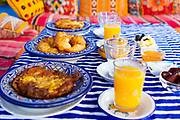 CHEFCHAOUEN, MOROCCO - 30th MARCH 2014 - Moroccan breakfast with 'sfenj' - a dough based pastry similar to a doughnut, Chefchaouen - the blue city - Rif Mountains, Northern Morocco.