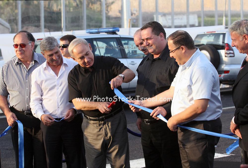 Israeli Prime Minister Benjamin (Bibi) Netanyahu (also Binyamin Netanyahu, born 21 October 1949) at a cutting of a ribbon ceremony November 11 2012. On his left is the Minister of Transport Yisrael Katz