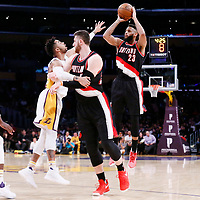 26 March 2016: Portland Trail Blazers guard Allen Crabbe (23) takes a jump shot over Los Angeles Lakers guard D'Angelo Russell (1) during the Portland Trail Blazers 97-81 victory over the Los Angeles Lakers, at the Staples Center, Los Angeles, California, USA.