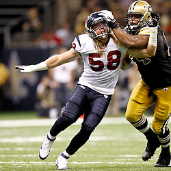 September 25, 2011; New Orleans, LA, USA; Houston Texans linebacker Brooks Reed (58) rushes against New Orleans Saints offensive tackle Jermon Bushrod (74) during the third quarter at the Louisiana Superdome. The Saints defeated the Texans 40-33. Mandatory Credit: Derick E. Hingle