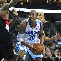 02 February 2009:  New Orleans Hornets forward David West (30) is defended by Portland Trailblazers forward Travis Outlaw (25) during a 97-89 loss by the New Orleans Hornets to the Portland Trail Blazers at the New Orleans Arena in New Orleans, LA.