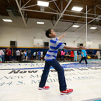 Thomas Wells | BUY AT PHOTOS.DJOURNAL.COM<br /> Peyton Bumphis, 12, plays with the balancing stick at Milam Elementary School on Friday as students go from station to station learning about science and what it can do.
