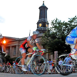 Joseph Schmalz, of Elbowz Racing who won the Pro Men's Iron Hill Twilight Criterium is seen here in passing the Historic Chester County courthouse on Market Street in West Chester. TK4