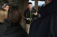 Duncan Smallman showing a group of participants examples of cooked seaweed after one of his tours foraging for seaweed on the rocky shore of Easdale island in Argyll. Dr Smallman runs Slate Islands Seaweed, which offers people guided foraging tours of Easdale and neighbouring islands to identify and gather the many types of edible seaweed found in the local environment. Marine biologist Dr Smallman started the tours in 2016 and also supplies edible seaweed for a number of restaurants and catering outlets.