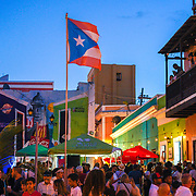 SAN JUAN, PUERTO RICO -- FEBRUARY 3, 2019: <br /> Locals and tourists enjoy the music blaring from speakers in the Callejon de la Calle Tanca (Tanca Street alley) in Old San Juan on a Sunday afternoon. The spot is a popular destination to enjoy live traditional Puerto Rican Bomba and Plena music.  <br /> (Photo by Angel Valentin)