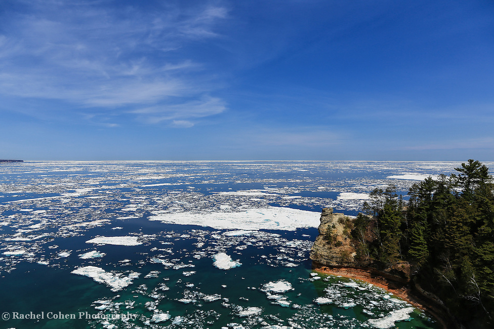 &quot;Icebergs at Miner's Castle&quot;<br /> <br /> An amazing view of Lake Superior and Miner's Castle in late spring of 2014. Plenty of icebergs remain in Munising Bay, while solid ice is still further out on the lake!!<br /> <br /> The Great Lakes by Rachel Cohen