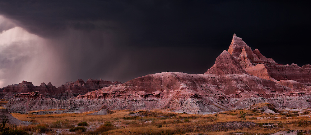 A severe thunderstorm turns day into night over Badlands National Park in South Dakota, USA