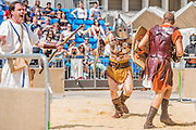 A fight ends in execution by a slit throat (with fake blood sack!) - Gladiators gather on the site of London's only performers that worked on Ridley Scott's Gladiator film will clash on the spot where gladiators battled 2,000 years ago in the courtyard of the Guildhall. Ten public evening and matinee performances will take place on selected dates between 8 and 16 August. Full information and tickets at www.museumoflondon.org.uk<br /> <br /> <br /> Hidden for centuries, the ancient remains of London's Roman amphitheatre were discovered by archaeologists in 1988. They are open for viewing all year. The Gladiator Games are performed by Britannia, renowned for its work on the Ridley Scott film, Gladiator. Each performance is the result of research into events in the 1st century A.D., using images drawn from Roman coins, paintings, sculpture and mosaics.
