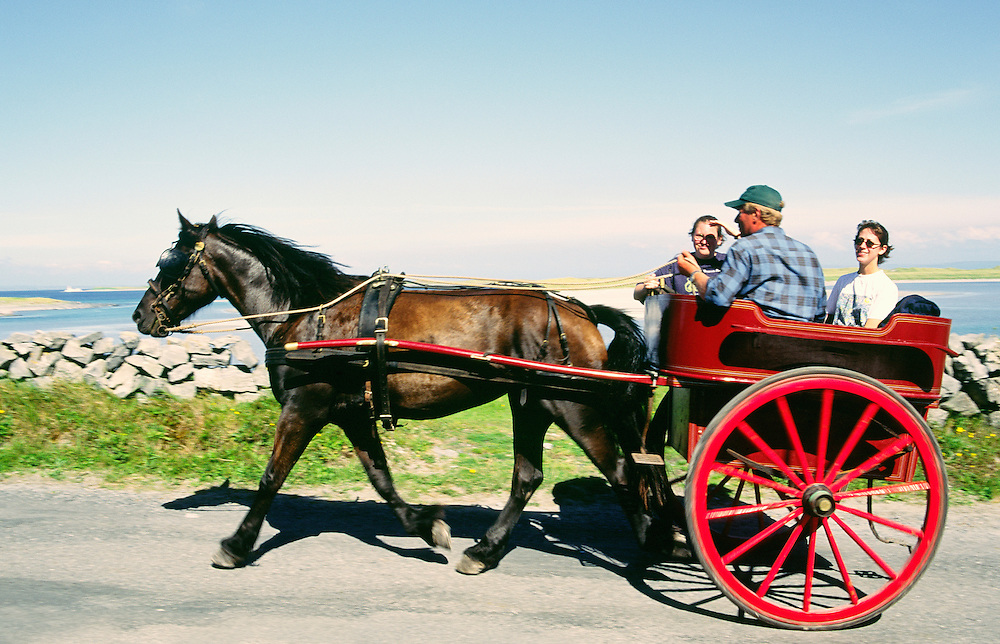 Traditional Irish horse drawn jaunting car as taxi at Kilronan on the island of Inishmore in the Aran Islands, Galway, Ireland