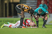 Richard Chaplow (Doncaster Rovers) lays hurt in the penalty box during the Sky Bet League 1 match between Doncaster Rovers and Port Vale at the Keepmoat Stadium, Doncaster, England on 26 January 2016. Photo by Mark P Doherty.