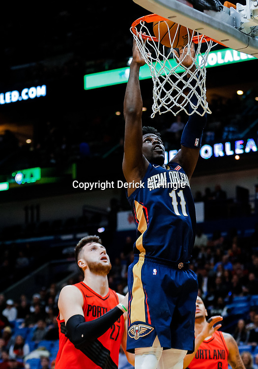 Jan 12, 2018; New Orleans, LA, USA; New Orleans Pelicans guard Jrue Holiday (11) dunks over Portland Trail Blazers center Jusuf Nurkic (27) during the first quarter at the Smoothie King Center. Mandatory Credit: Derick E. Hingle-USA TODAY Sports
