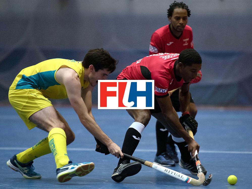 BERLIN - Indoor Hockey World Cup<br /> Trinidad &amp; Tobago - Australia<br /> foto: Mickell Pierre <br /> WORLDSPORTPICS COPYRIGHT FRANK UIJLENBROEK
