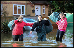 Resident with some of their belongings in Egham, Surrey,  United Kingdom,  evacuate their homes as floods hit Britain, Thursday, 13th February 2014. Picture by Andrew Parsons / i-Images
