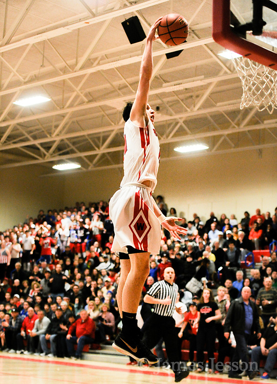 Watertown High School junior John Korte takes the ball to the rim during the MIAA Division 3 North Sectional Final game against Bedford High School at Burlington High School, March 11, 2017. The Raiders won, 59-52.    [Wicked Local Photo/James Jesson]