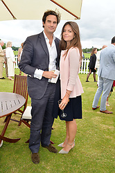 MR RUPERT & LADY NATASHA FINCH at the Cartier Queen's Cup Final polo held at Guards Polo Club, Smith's Lawn, Windsor Great Park, Egham, Surrey on 15th June 2014.