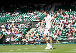 LONDON, ENGLAND - Wednesday, June 30, 2010: Andy Murray walks past empty seats on Centre Court during the Gentlemen's Singles Quarter-Final on day nine of the Wimbledon Lawn Tennis Championships at the All England Lawn Tennis and Croquet Club. (Pic by David Rawcliffe/Propaganda)
