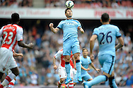 Manchester City's Frank Lampard heading the ball. Barclays Premier league match, Arsenal v Manchester city at the Emirates Stadium in London on Saturday 13th Sept 2014.<br /> pic by John Patrick Fletcher, Andrew Orchard sports photography.