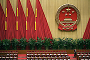 A delegate arrives early for a session of China's National People's Congress in the Great Hall of the People.
