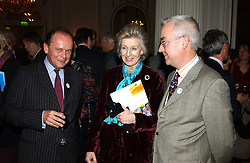 Left to right, TONY CLARKSON, HRH PRINCESS ALEXANDRA and DR ANDREW MCCULLOCH chief executive of the charity at a reception following a charity carol service in aid of the Mental Health Foundation attended by HRH Princess Michael of Kent and held at the Hype Park Mandarin Oriental Hotel, Knightsbridge, London on 30th November 2004.<br />