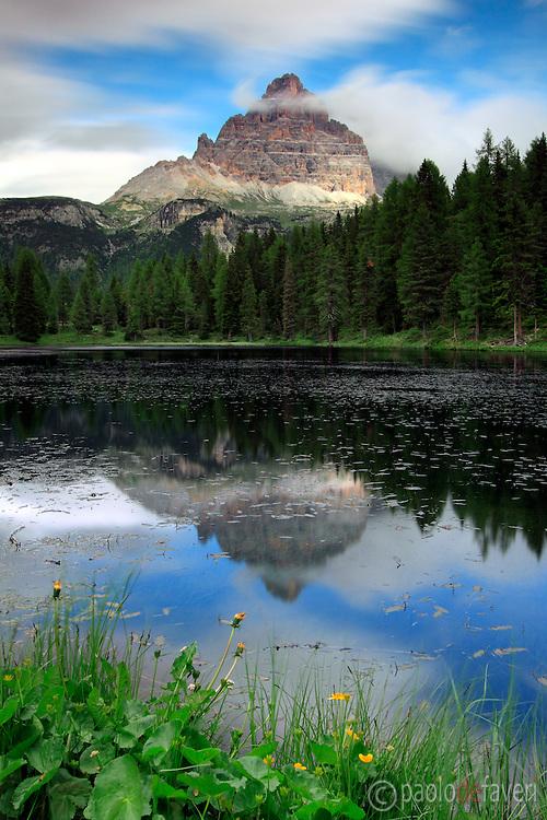 Tre Cime di Lavaredo (Drei Zinnen) reflected in the waters of Lake Antorno, area of Misurina in Veneto, Italy