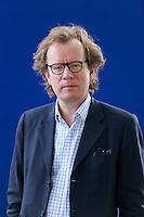 Edinburgh International Book Festival 2013 portrait of Mark Huband at Charlotte Square Garden <br /> <br /> Pic by Pako Mera