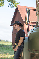 hot cowboy leaning on a truck