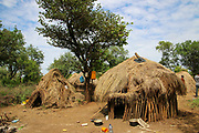 Thatched huts in a Mursi village. A nomadic cattle herder ethnic group located in Southern Ethiopia, close to the Sudanese border. Debub Omo Zone, Ethiopia