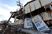 Vending machines by a destroyed building in the town of Tomioka, Futaba District of Fukushima, Japan. Monday April 29th 2013. The town was evacuated on March 12th after the March 11th 2011 earthquake and tsunami cause meltdowns at the nearby Fukushima Daichi nuclear power station. It lies well within the 20 kms exclusion zone though parts of the town have recently been opened again to allow locals to visit their property during daylight hours.