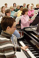 With Amy Gray at the piano, the women of the Dayton Philharmonic Chorus rehearse for their upcoming performance of Mahler's Third Symphony, Tuesday, January 2, 2007.