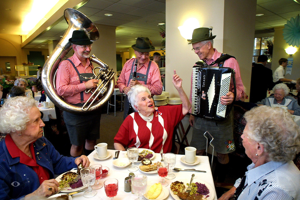 Justine Comte (center) sings a little ditty during an Octoberfest dinner at Calaroga Terrace. She and her friends were treated to strolling German music provided by Halderman's Oom-Pah Band.
