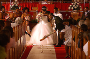 "Best man Chevon Schand, 17, lays down a decorative broom for the bride, Betty Lynn Lauray, 20, and his brother (the groom), Shamel Lateek Schand, 23, for the ""Jumping of the Broom"" ritual at a wedding ceremony at Shiloh Baptist Church on Albany Avenue in Hartford, Conn. on May 8, 2004. The ""Jumping of the Broom"" is an African wedding ritual that was used by enslaved Africans in America. It is a tradition still used at many Black weddings to consummate the marriage ceremony. The couple, originally from Hartford, now live in Manchester, Conn. The couple honeymooned at a Bed and Breakfast in North Stonington, Conn.   cq names"